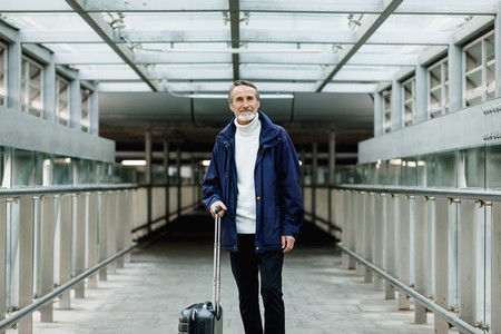 Mature male walking with baggage