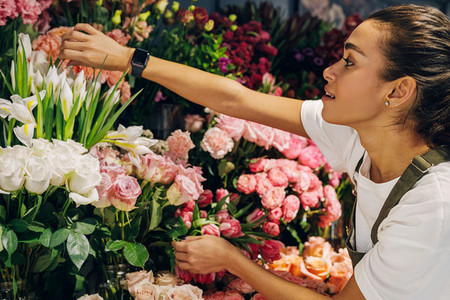 Florist woman choosing a flower