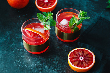 Refreshing cold summer cocktail with blood orange and mint