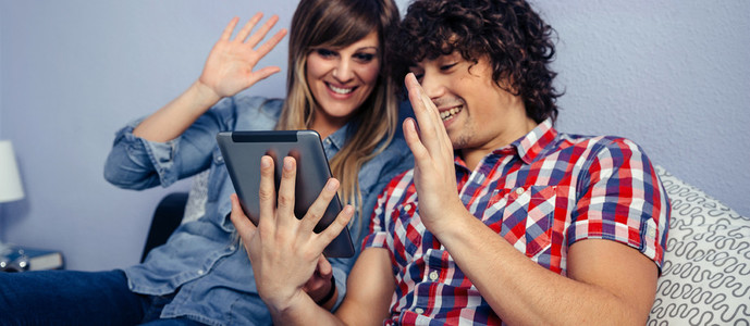 Couple making video call with the tablet