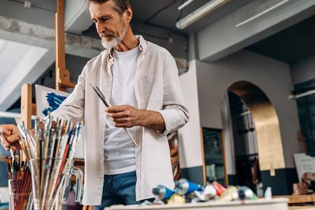 Senior artist standing in studio