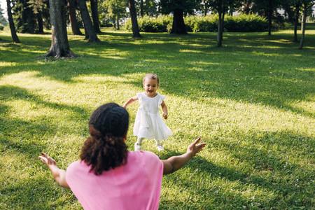 Happy little girl running