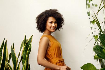 Smiling woman posing at the wall