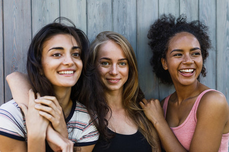 Three beautiful smiling women