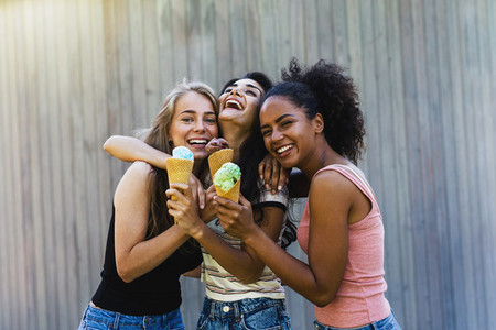 Three laughing girl friends
