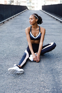 Healthy female athlete sitting