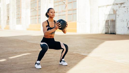 Female athlete doing squat