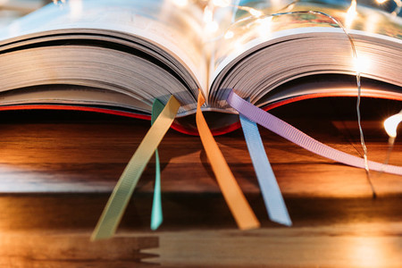 Open book with colorful bookmarks on a table Education or leisure concept
