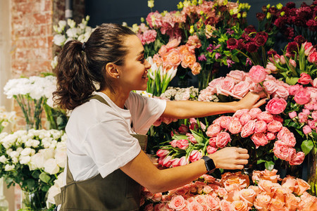 Woman florist picking flower