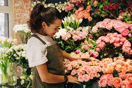 Woman florist wearing apron