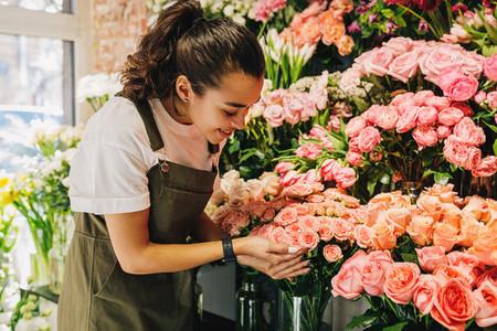 Smiling florist woman looking