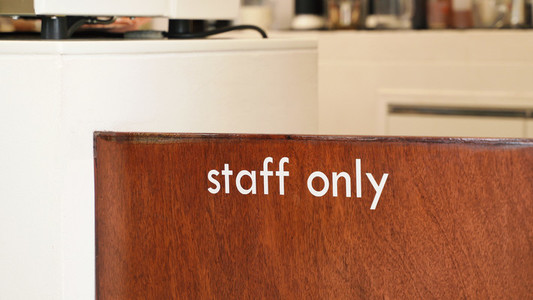 Close up of staff only sign at the wooden door cafe or restauran