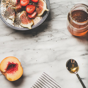 Healthy breakfast with yogurt  fruits and honey  square crop