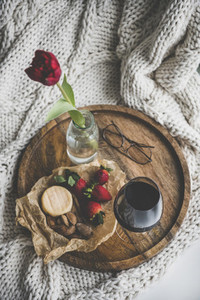 Glass of wine  different snacks and red tulip in jar