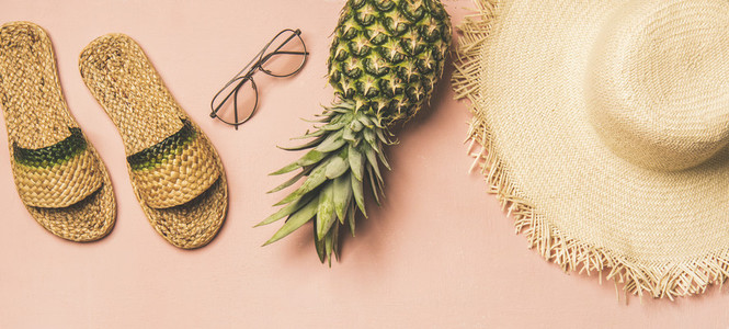Variety of summer apparel items and fresh pinapple  wide composition