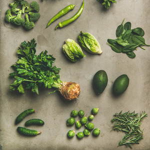 Healthy vegan ingredients layout over concrete table background  square crop