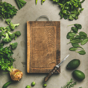 Healthy vegan ingredients and wooden board in center square crop