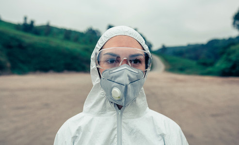 Woman with bacteriological protection suit