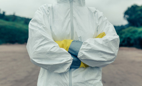 Unrecognizable woman wearing bacteriological protective suit