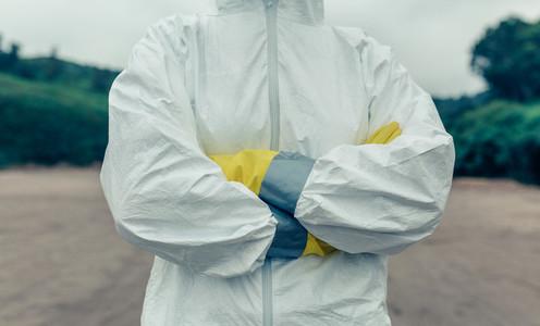 Unrecognizable woman wearing bacteriological protective suit