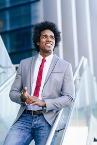 Black Businessman with afro hair standing outdoors