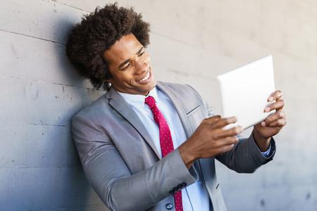 Black Businessman using a digital tablet in urban background