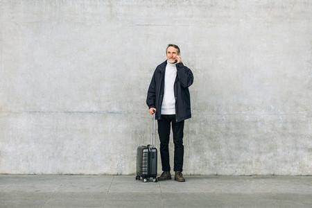 Senior man with suitcase