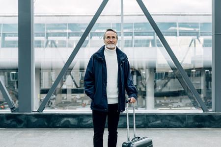 Handsome mature traveler