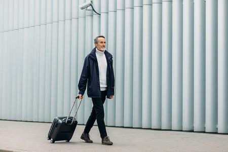 Senior tourist with luggage