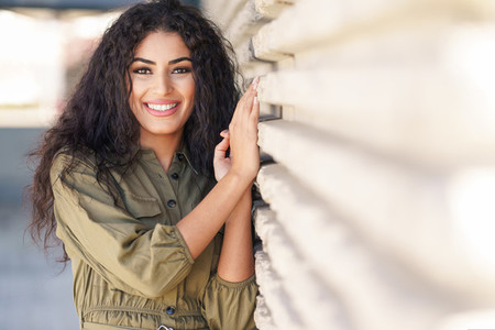 Young Arab Woman with curly hair outdoors
