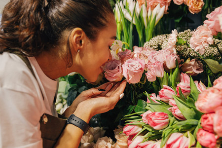 Close up of a woman smelling