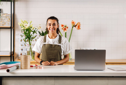 Smiling woman in apron standing