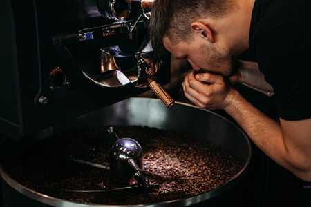 Man smelling coffee beans