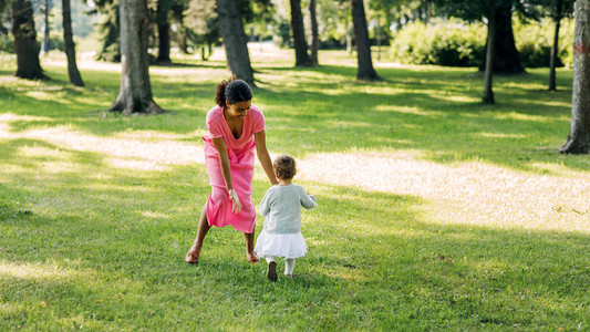 Young mother playing in the park