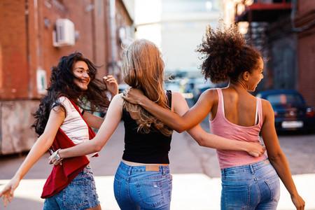 Back view of young women walking