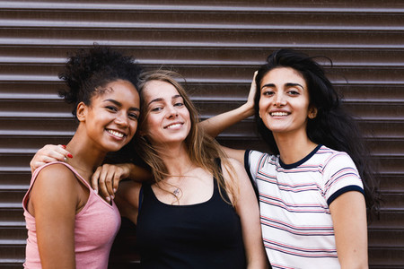 Smiling female friends standing