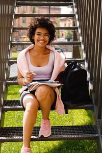Happy student sitting