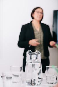 Unfocused businesswoman talking in in the office
