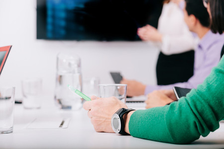 Close up human arm with watch in a meeting