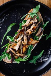 Vegan sandwich with fresh arugula fried shiitake mushroom and shallot onion