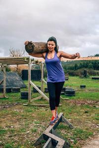 Sportswoman carrying trunks