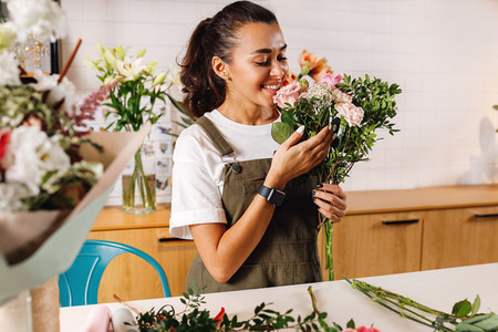Happy female florist