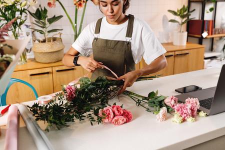 Woman florist making a bouquet