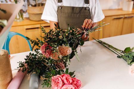 Hands of female florist making
