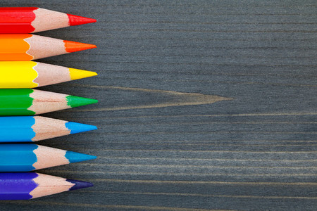 Top view on colored pencils on a blackboard  Macro shot