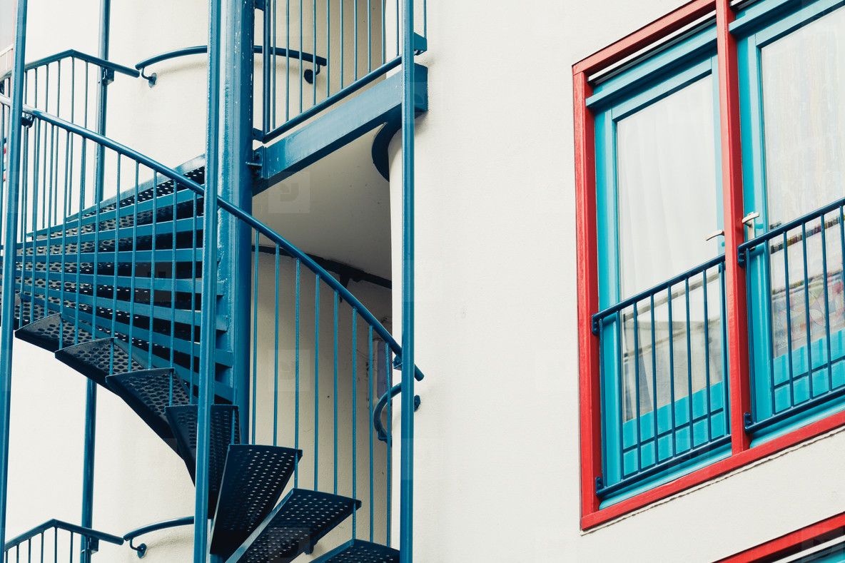 Architectural colorful details of the modern house in Europe  Blue spiral staircase and window