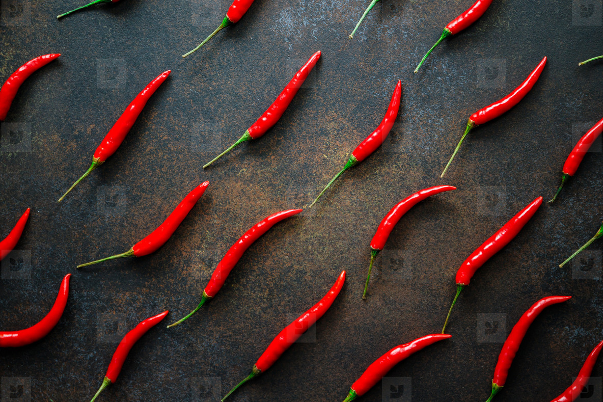 A lot of chili peppers on a kitchen table  Top view