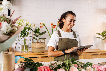 Young female florist making