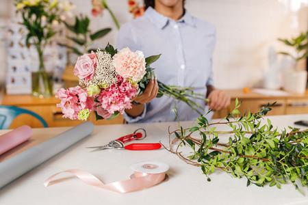 Unrecognizable woman florist