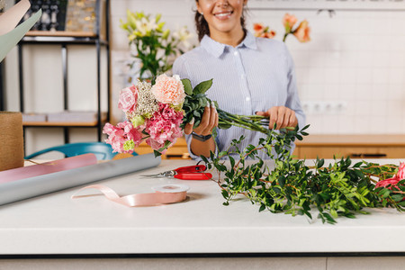 Smiling female florist